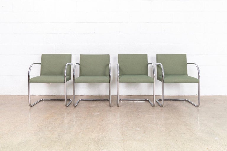 This set of four Mies van der Rohe Brno armchairs made by Gordon International are circa 1990. These iconic Mid-Century Modern chairs designed by Mies van der Rohe in 1930 feature clean lines and a simple profile. Model 504 has a cantilevered frame