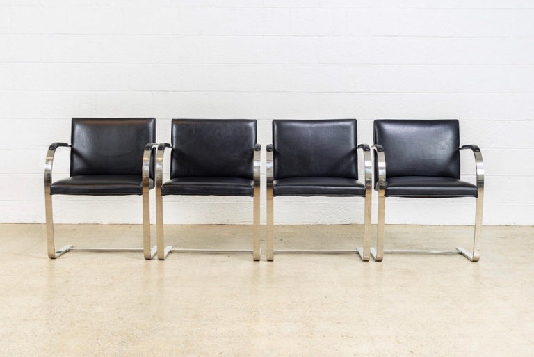 This set of four Ludwig Mies van der Rohe Brno flat bar armchairs manufactured by Knoll are, circa 1990. These iconic midcentury chairs designed by Mies van der Rohe in 1930 feature clean lines and a simple profile. This set features a steel frame