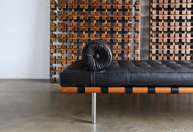 Black leather and walnut daybed by Mies van der Rohe for Knoll, 1983. This piece is in very good original condition with a beautiful patina to the original leather. Retains the original Knoll International tag to the cushion. Retains the original
