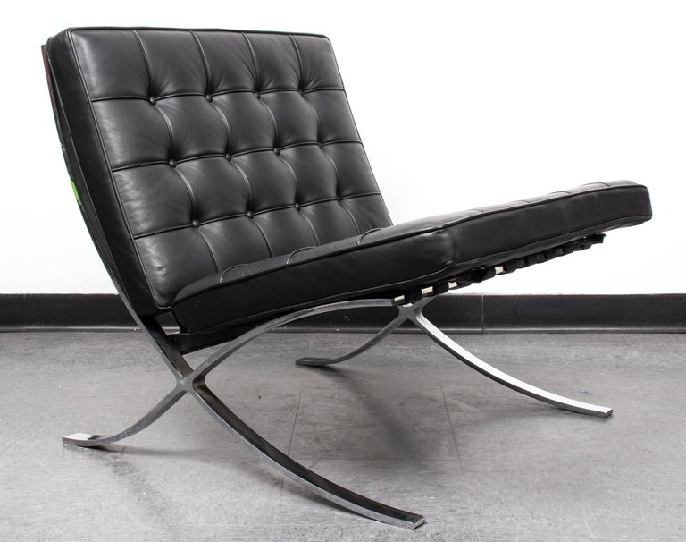 Mies van der Rohe Mid-Century Modern Barcelona chair, with rare chromed split frame and black leather upholstery. Measures: 29.25