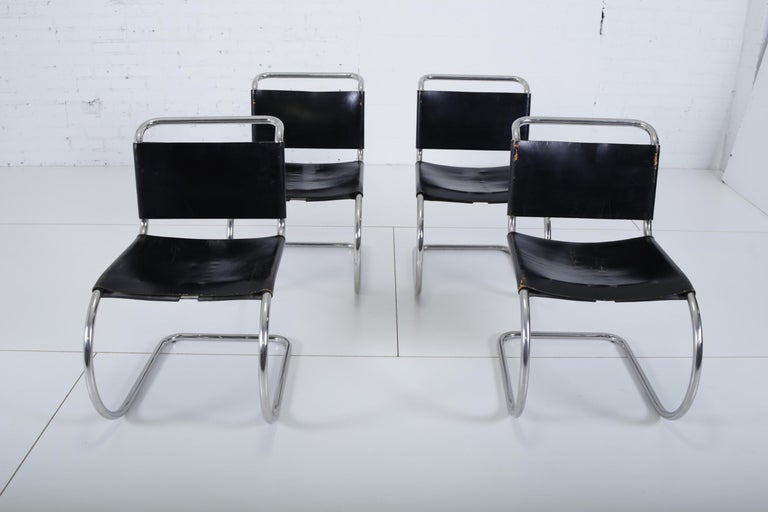 Set of 4 original 1960s MR10 dining chairs designed by Mies van der Rohe for Knoll. Original leather and stainless steel frames are in great shape. Chairs have early Knoll labels.
