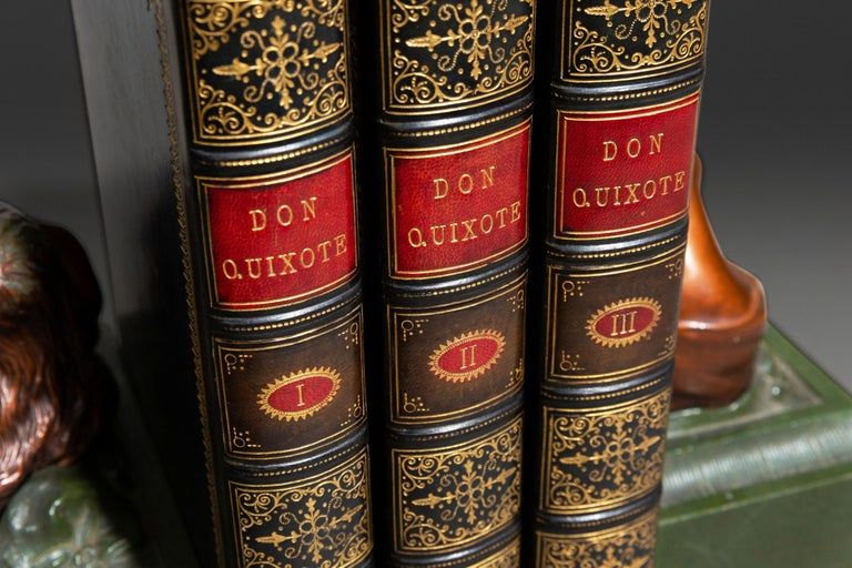 3 Volumes. Cervantes. Don Quixote De La Mancha. Translated By Charles Jarvis, Esq. Illustrated By Tony Johannot. Bound In Full Blue Polished Calf, marbled Endpapers and Edges, Raised Bands, Ornate Gilt On Spines, gilt on covers. Published: London: