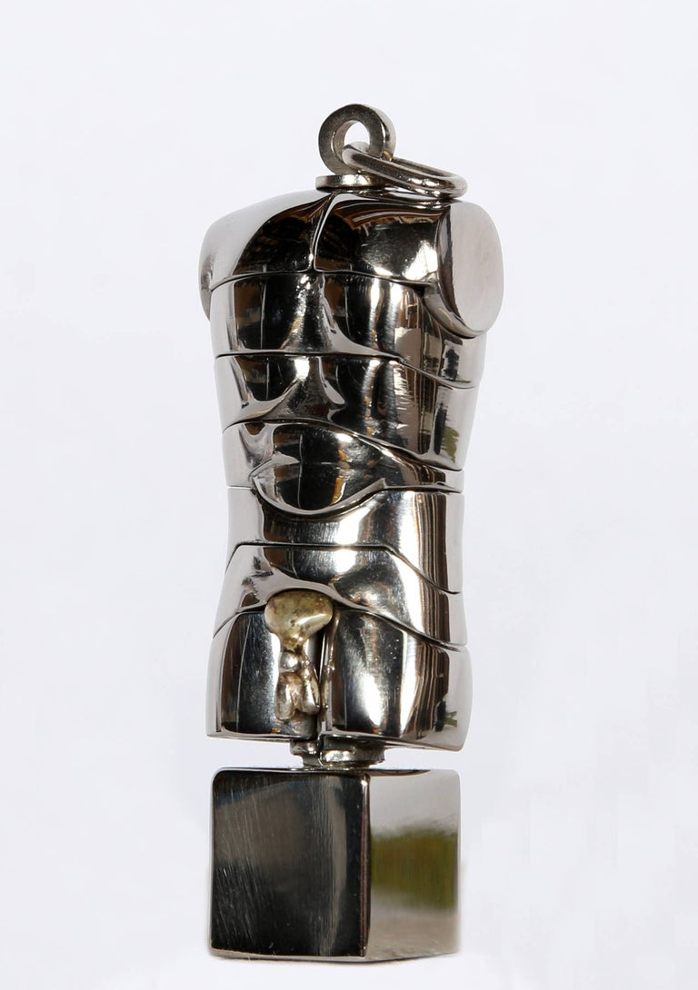 A puzzle sculpture by Miguel Berrocal circa 1976. This sculpture comes apart in 23 pieces.  Comes in original box with booklet.    Artist: Miguel Berrocal, Spanish (1933 - 2006) Title: Micro David Off Year: 1975-1976 Medium: Nickel Plated Brass