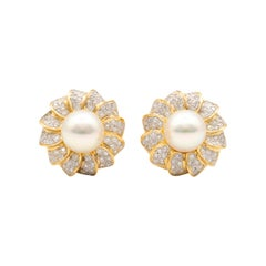 Mikimoto Pearl and Diamond Flower Earrings in 18K yellow gold.