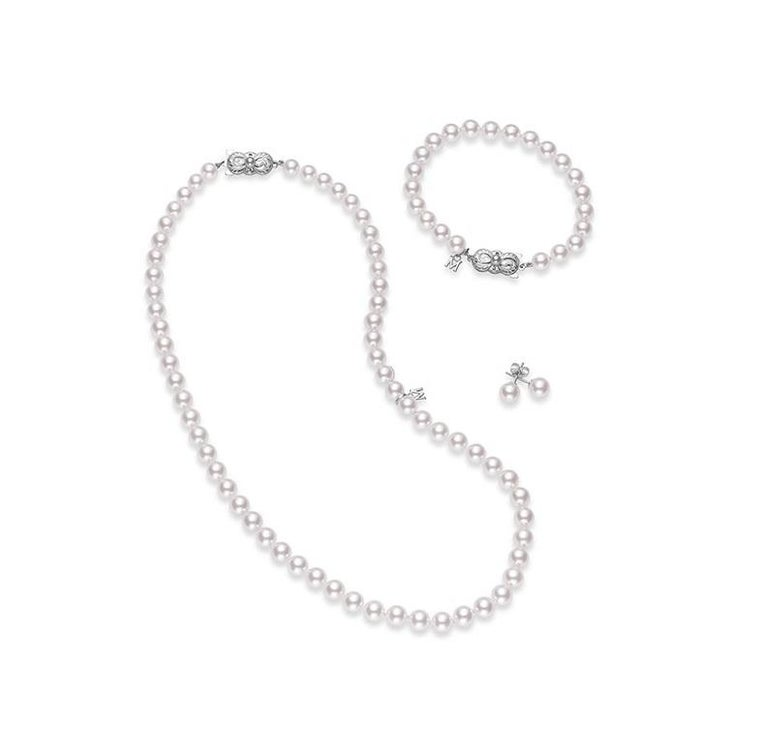 Mikimoto Akoya Cultured Pearl Three Piece Set with 18K White Gold Clasp.  This 18 inch Akoya cultured pearl strand features 7x6mm Akoya cultured pearls with a MIKIMOTO signature clasp in 18K white gold. Together with the matching 7mm A1 quality