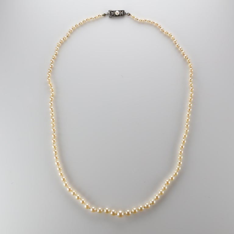 Mikimoto Kōkichi became fascinated with pearls as a young child in Japan. He would in time invent a process for creating what became the first cultured pearl —a blister pearl— and later seed pearls and half-pearls. In 1920 Mikimoto achieved his