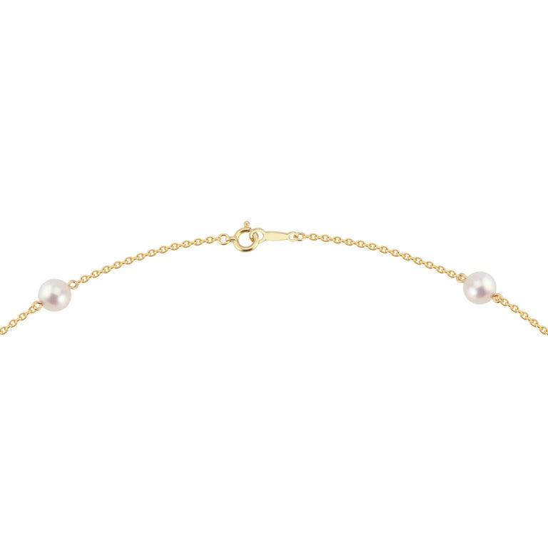 Mikimoto 9 pearl station necklace in 18k yellow gold.  6mm pearls with a rose hue. 18 inches.   9 cultured rose hue pearls 18k yellow gold  5.0 grams Stamped: 750 Hallmark: M Chain: 18 Inches