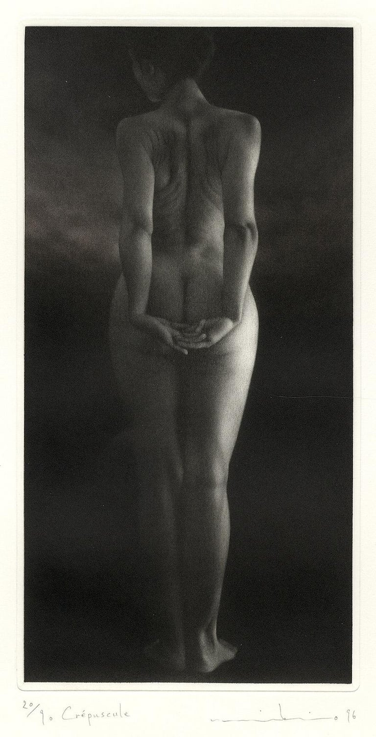 Crepuscule (literally means Dusk. Standing young nude woman facing away) - Black Nude Print by Mikio Watanabe