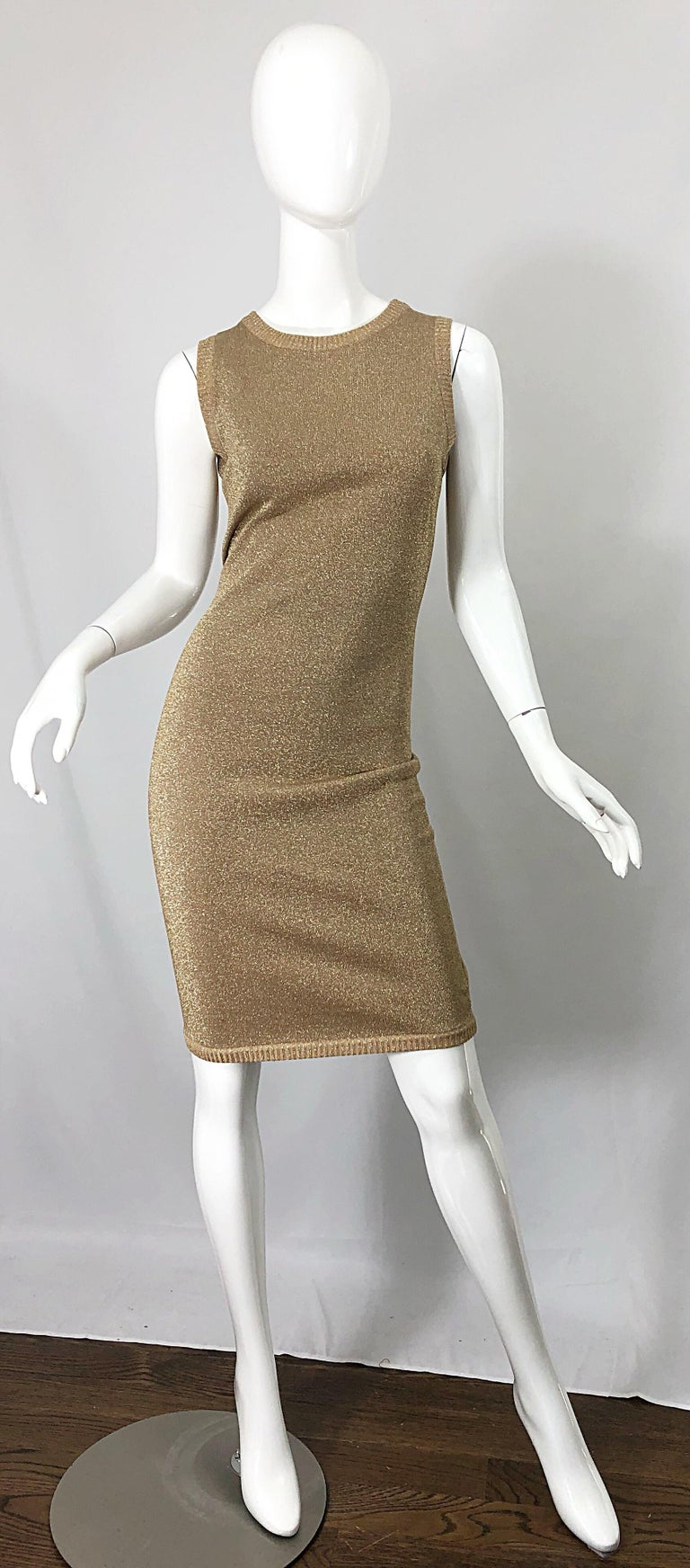 Sexy 1990s does 1960s MILA SCHOON gold metallic cut-out back bodycon dress! Features a soft Cotton blend that stretches to fit. Simply slips over the head. Cut-out back reveals just the right amount of skin. Great belted or alone with sandals,
