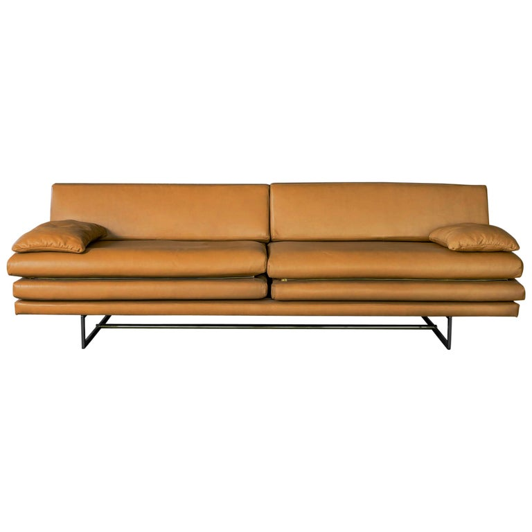 The Milan leather sofa has an angular painted stainless steel base and has custom color and material options. The aesthetic of this piece comfortably straddles the line between art and functionality, a philosophy that has drawn inspiration from