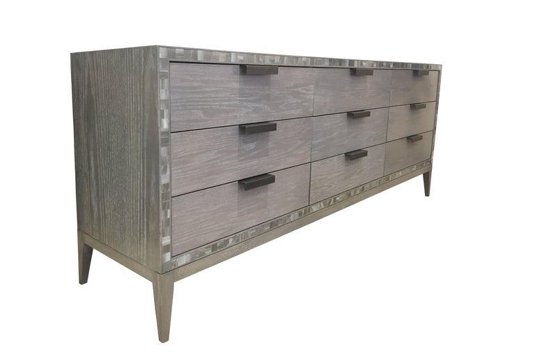 The Milano chest of 9 drawers by Ercole Home consisted of 9 drawers all adorned with handmade industrial steel pulls. The chest its self is painted in our personal Earl Gray Ceruse Finish that compliments the natural grain of the oak wood. The