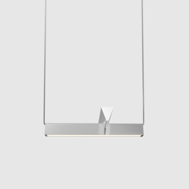 A collaboration between Lambert & Fils and Guillaume Sasseville, Mile offers a variation on the linear suspension, pared down to its simplest, asymmetrical expression, with two lines floating in surprising equilibrium. Direct and indirect light are