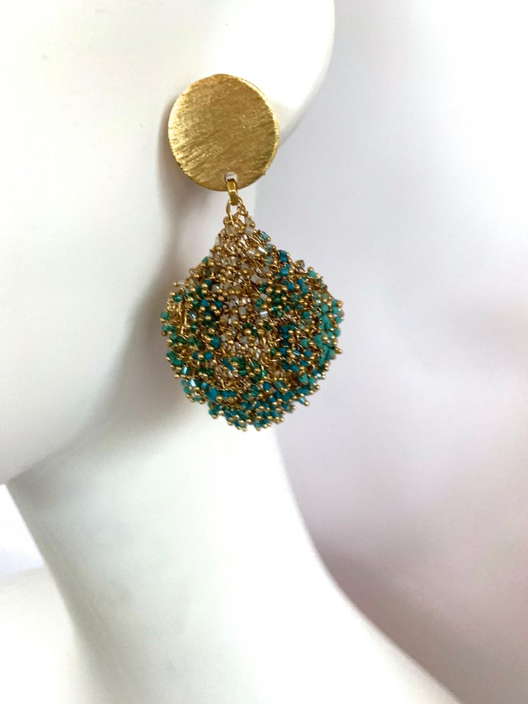 Turquoise bead and woven gold pierced earrings from Milena Zu.