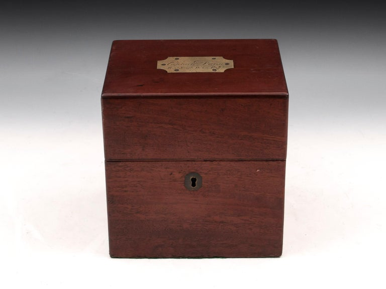 Antique Mahogany decanter box with flush brass carry handles, brass escutcheon and large plaque on the top which is engraved: