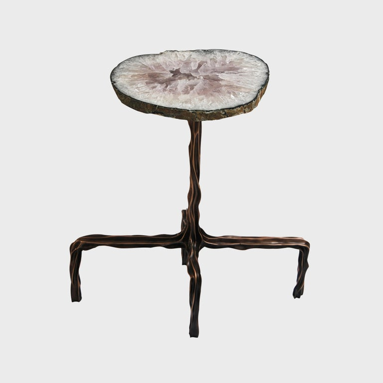 Cast in bronze from the artist's hand molded form, each Milla coctail table is made to order and hand finished. Stone tabletop finish options are available. Design by Fakasaka.