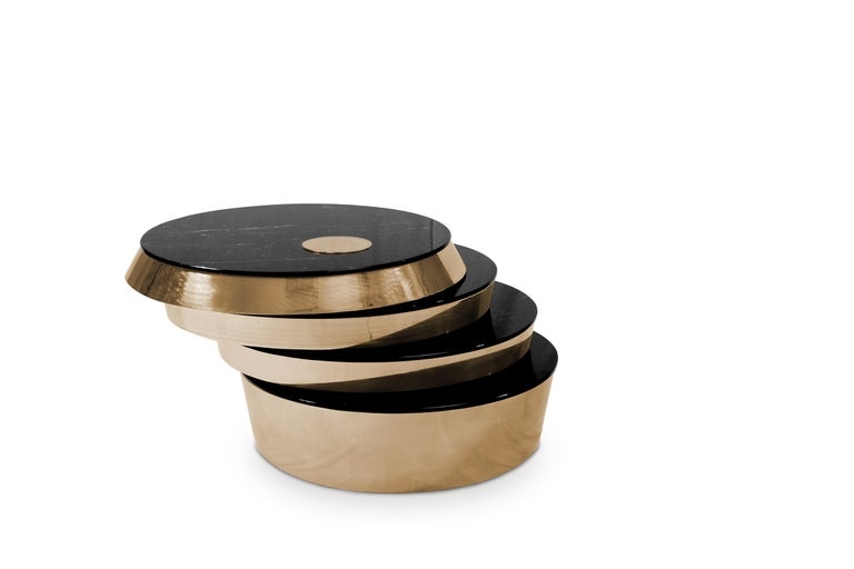 Miller is a stunning rotating center table with four layers. The massive marble top seems almost immovable but smoothly will turn with a push of a hand. The black marble makes the center table the head turner piece of every type of interior. Perfect