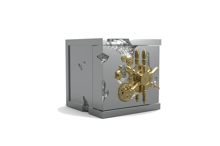 A small and portable version of the Millionaire Safe, the Millionaire Jewelry Safe is a statement piece influenced by the California Gold Rush and designed to cause an impression. Built in a gold-plated polished brass frame with dents that spark