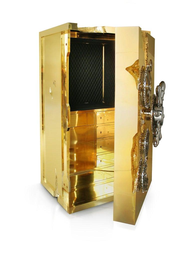Influenced by the California gold rush, the Millionaire safe is a statement piece designed to cause an impression. Built in a mahogany structure and gold-plated polished brass frame with several dents, it sparks both interest and imagination
