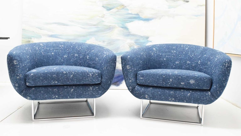 A great looking pair of overstuffed lounge chairs by Milo Baughman. You don't see these too often. They have a beautiful square chrome base. We updated the look with new upholstery by Donghia so they are fresh and ready to go.
