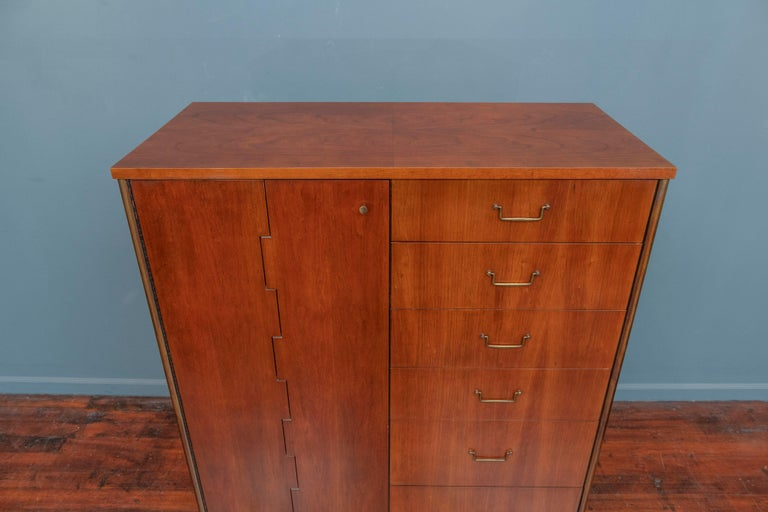 Milo Baughman cabinet from his Directional line for Calvin furniture company. Handsome and multi functional form chest or storage cabinet, made from cherry and oak with patinated brass hardware and frame. Featuring six drawers in graduating depths