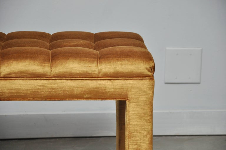 Biscuit tufted bench by Milo Baughman. Newly upholstered in gold velvet.