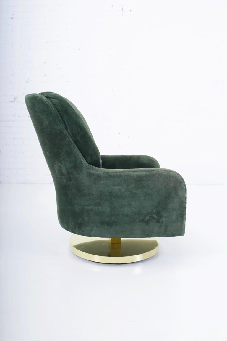 High back swivel chair with brass rocking base. Designed by Milo Baughman for Thayer-Coggin, circa 1970s.