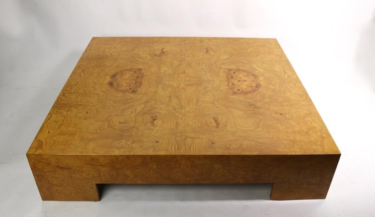 Extraordinary extra large square coffee table designed by Milo Baughman. Executed in all over burl, very fine, original, clean and ready to use condition.