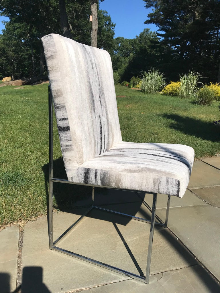 A most elegant and comfortable set of 6 Milo Baughman dining chairs, two armchairs and four side chairs.  One is reupholstered in a high quality contemporary fabric as a suggestion. We purchased enough fabric to reupholster the remaining chairs. The
