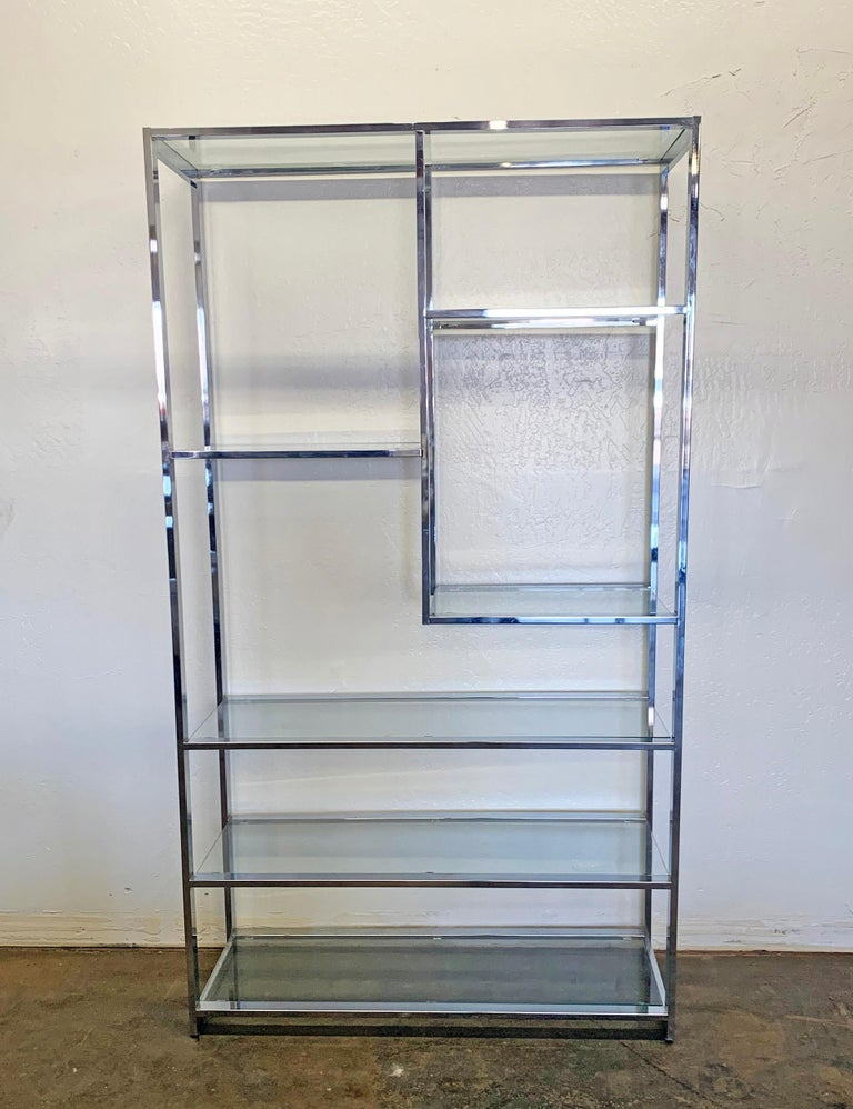 A wonderful and classic design by Milo Baughman, this chrome and glass étagère is complimentary to almost any style of contemporary design. The versatility of this piece allows it to be floated in the middle of a room and can be used as a room