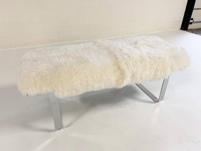 We keep picturing this amazing bench at the end of a beautiful bed. Our designers chose our soft and thick Brazilian sheepskin to pair perfectly with the slick and shiny chrome.  Measures: 49