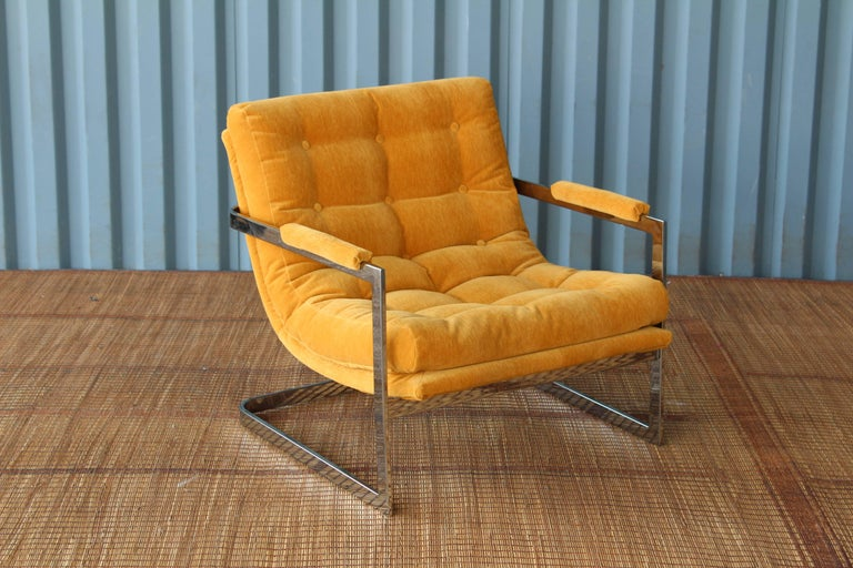 Chrome framed cantilevered lounge chair designed by Milo Baughman, 1960s. Fabulous condition with all new upholstery and polished chrome frame.