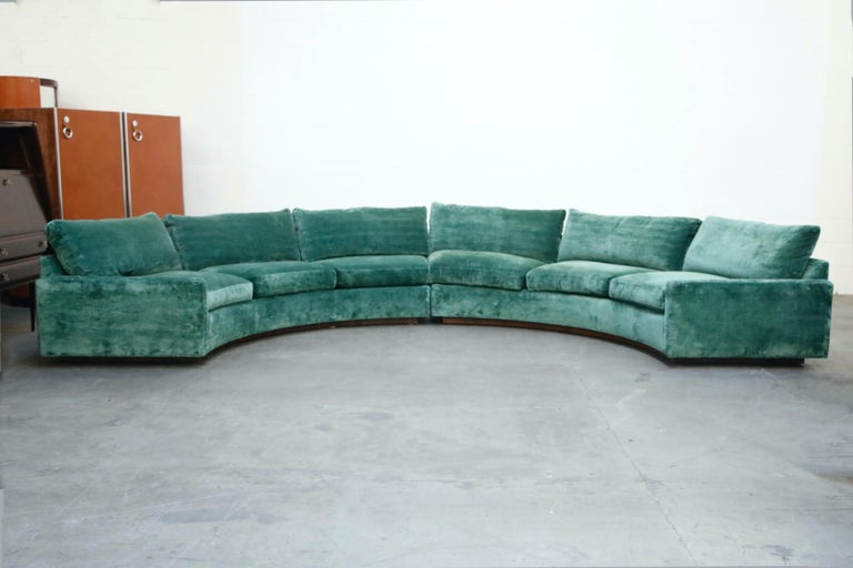 Extremely comfortable and increasingly rare, this large two piece sectional by Milo Baughman for Thayer Coggin, 1960s, features a curved semi-circle design on Rosewood plinth base. This example has been reupholstered in recent years in a teal