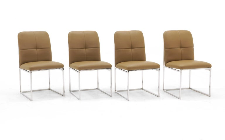 Set of four Milo Baughman dining chairs reupholstered in a tan leather. Beautiful set.