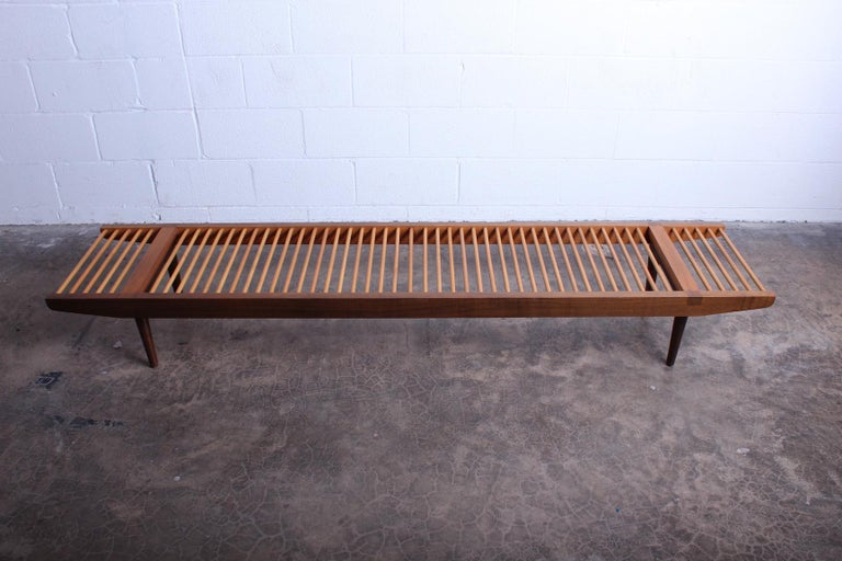 A maple and walnut dowel bench designed by Milo Baughman for Glen of California.