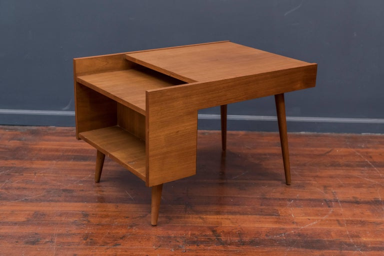 Milo Baughman design end table for Glenn of California with a magazine shelf and book cubby. Minimal modern walnut table in very good original condition.