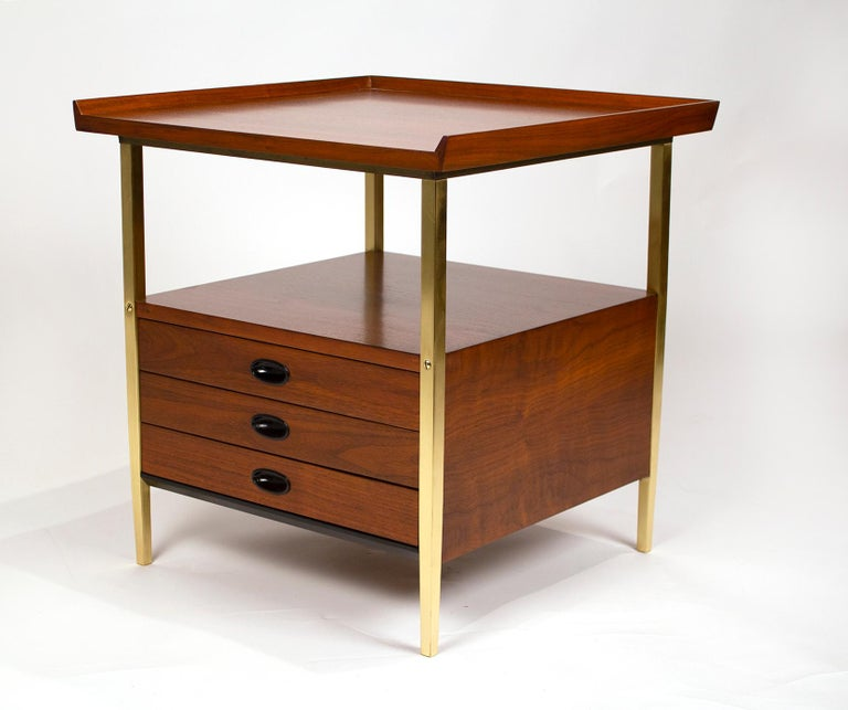 This is a pair of end tables/nightstands with three drawers designed by Milo Baughman for Arch Gordon. Both units have been professionally refinished and all of the solid brass legs have been removed, polished and re-lacquered. These early designs
