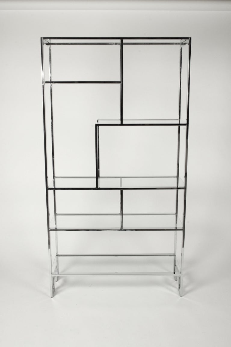 Chrome geometric configuration étagère by Milo Baughman for DIA or Design Institute of America with glass shelves and Greek key detail in base. Very nice original condition, chrome is bright, few minor chips to edges of glass and light scratches.