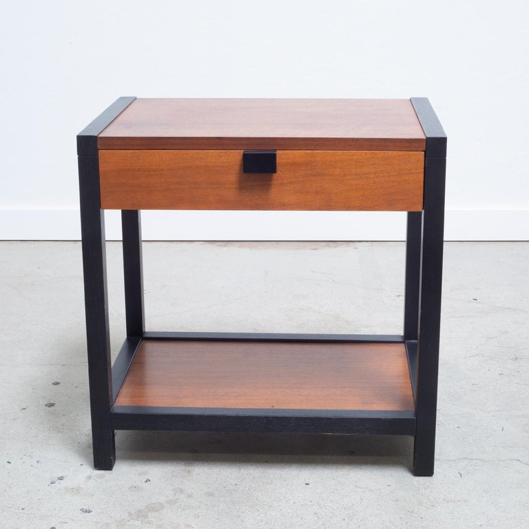 About  Mid-century nightstand designed by Milo Baughman for Directional. Walnut with dramatic contrasting black framing.   Creator Milo Baughman for Directional.  Date of Manufacturer c.1960.  Materials and Techniques Walnut.  Conditions