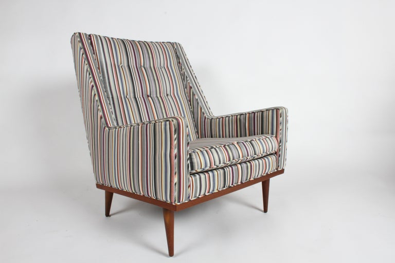 Milo Baughman for James Inc. King lounge chair, part of his articulate seating collection with Classic midcentury lines. This chair was reupholstered at some point in the last 10 years with a very handsome Paul Smith looking stripe upholstery,