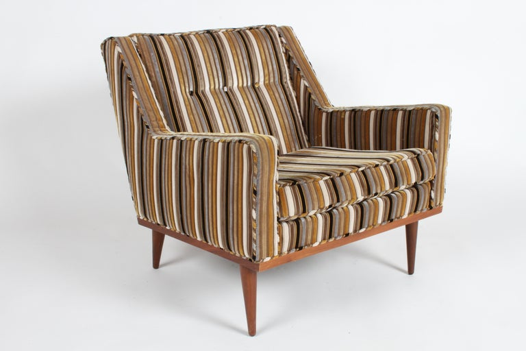 Milo Baughman for James Inc. low back lounge chair, part of his articulate seating collection with classic Mid-Century lines. This chair has its original wide velvet stripe upholstery and walnut finished frame. Upholstery is in surprisingly good