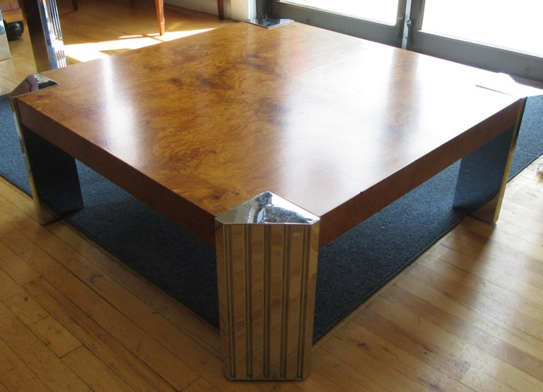 A bookmatched olive burl wood coffee table with chromed