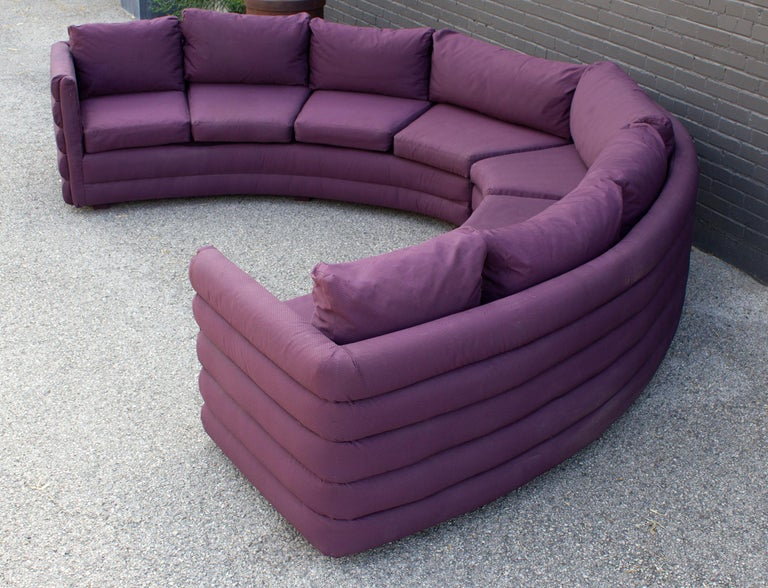 This Milo Baughman sofa is the epitome of 1970s high style design. The two-pieces together make a slightly acute semicircle. The foam-filled channels across the back and on the armrests create a visually stunning effect. Milo Baughman was the master