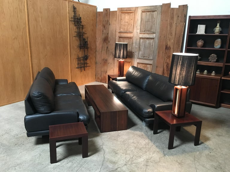 Postmodern floating black leather sofas with platinum finish legs very comfortable.