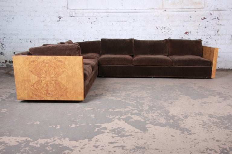 A stunning Mid-Century Modern sectional case sofa designed by Milo Baughman for Thayer Coggin. The sofa features gorgeous book-matched burled olive wood in a butterfly pattern on each end and original brown upholstery. It is plush and very