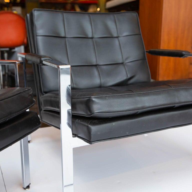Nice pair of flat bar chrome chairs with original black Naugahyde cushions.