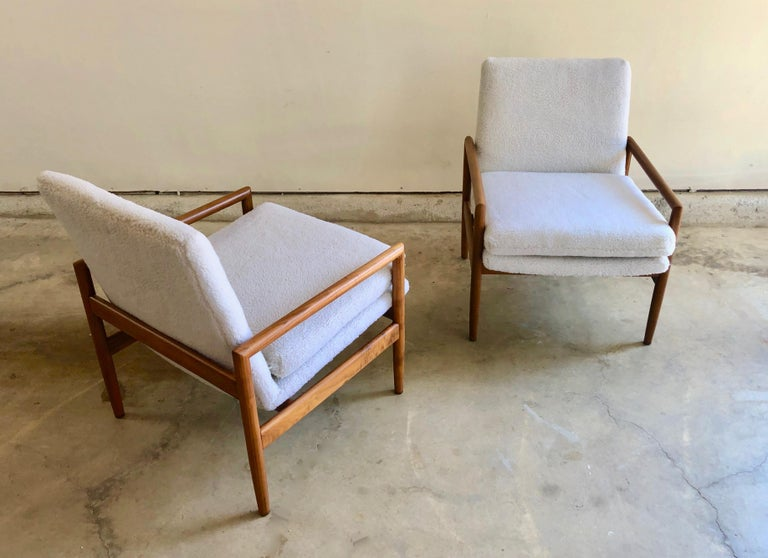 A very rare pair of Milo Baughman for Thayer Coggin lounge chairs. These are an earlier model that include the original labels. These chairs have been restored in a faux teddy bear ivory Sherpa fabric. Very modern and trendy. These are a true