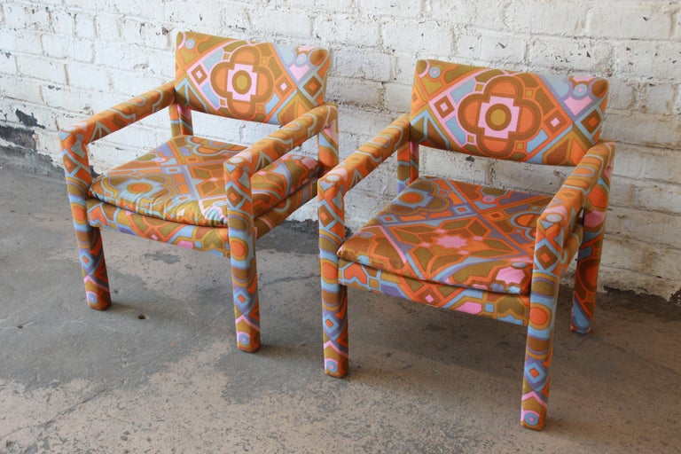 An exceptional pair of Parsons club chairs designed by Milo Baughman for Thayer Coggin. The chairs feature sleek mid-century modern design and outstanding Jack Lenor Larsen fabric. These are true statement pieces for any modern or Boho Chic