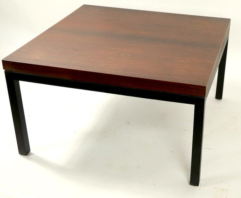 Classic Baughman for Thayer Coggin end, side, or occasional table with a rosewood veneer top on squared ebonized leg base. This example is in very good, original condition showing only light cosmetic wear, normal and consistent with age, it retains