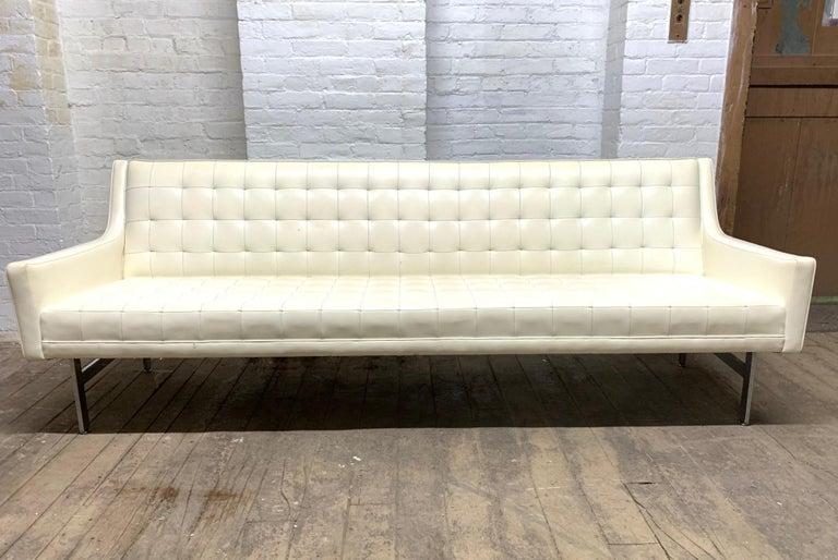 Milo Baughman for Thayer Coggin tufted sofa. Sofa is white vinyl with chrome legs. Mid Century Modern.