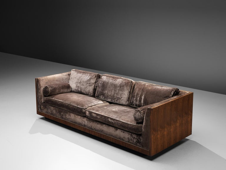 Milo Baughman, sofa, grey velvet, rosewood, United States, circa 1965  This three-seat 'basket' sofas is designed in circa 1965. The soft colored cushions fall perfectly in the rosewood frame of this settee. The design of this sofa is very